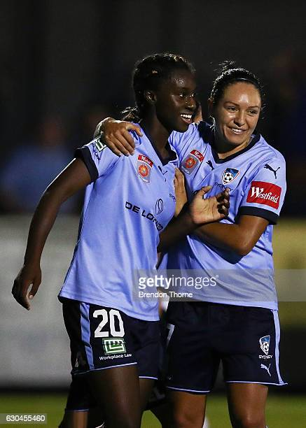 Princess IbiniIsei of Sydney celebrates with team mate Kyah Simon after scoring a goal during the round eight WLeague match between Sydney and...