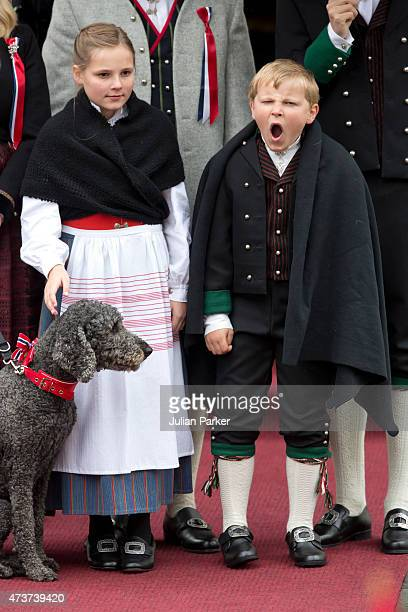 Princess Ingrid Alexandra and Prince Sverre Magnus of Norway watch the traditional morning children's parade, at their home, Skaugum, in Asker, near...