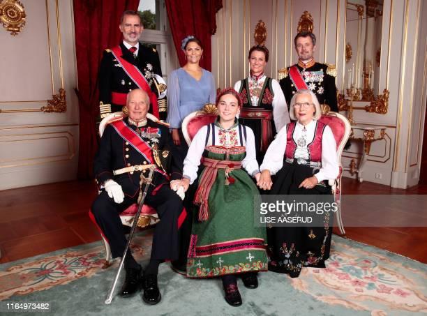 Princess Ingrid Alexandra wearing a national costume Raudtroyebunad poses with her godparents King Felipe VI of Spain Crown Princess Victoria of...