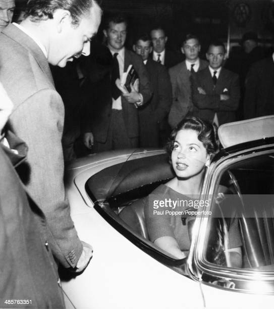 Princess Ira von Furstenberg in a Mercedes at the International Motor Show at Earl's Court in London 17th October 1957 She is looking up at her...