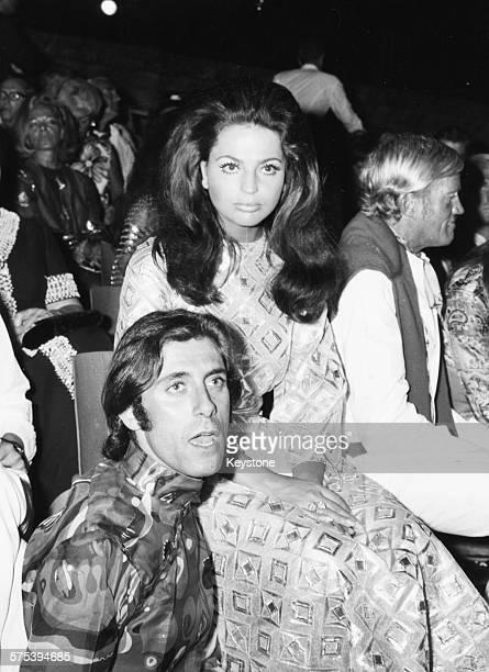 Princess Ira von Furstenberg with Italian actor Gigi Rizzi at a fashion show in Capri circa 1965