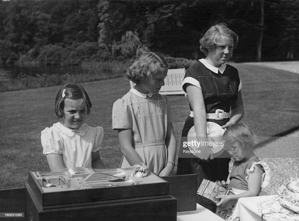 Princess Irene of the Netherlands (centre) celebrates her thirteenth birthday with her sisters at Soestdijk Palace, Netherlands, 5th August 1952. Left to right: Princesses Margriet, Irene, Beatrix and Christina.