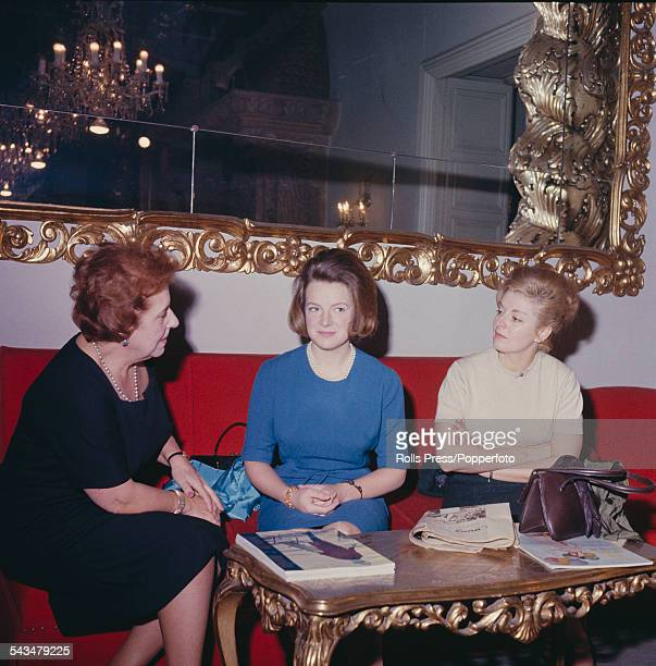 Princess Irene of the Netherlands pictured in centre wearing a blue dress attends a fashion show in Madrid Spain in February 1964
