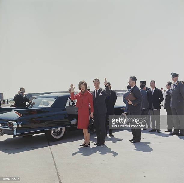 Princess Irene of the Netherlands pictured with future husband Carlos Hugo Duke of Parma standing together beside a limousine car at an airport as...