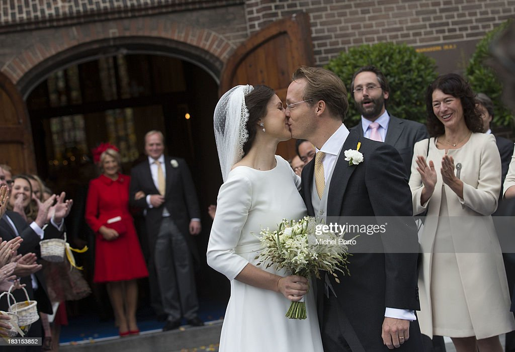 L-R Princess Irene, Prince Carlos look on as Viktoria Cservenyak and Prince Jaime de Bourbon Parme kiss after leaving the Church Of Our Lady At Ascension on October 5, 2013 in Apeldoorn, Netherlands.