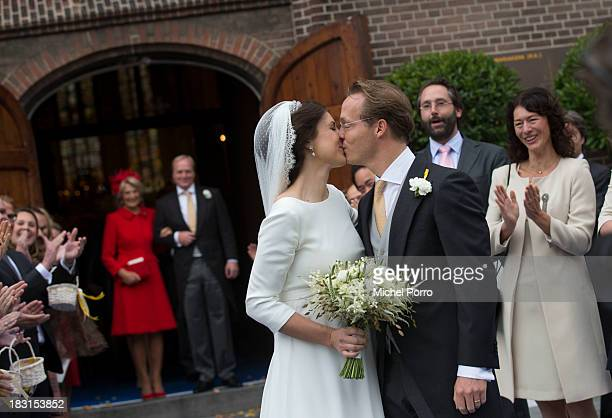 Princess Irene Prince Carlos look on as Viktoria Cservenyak and Prince Jaime de Bourbon Parme kiss after leaving the Church Of Our Lady At Ascension...