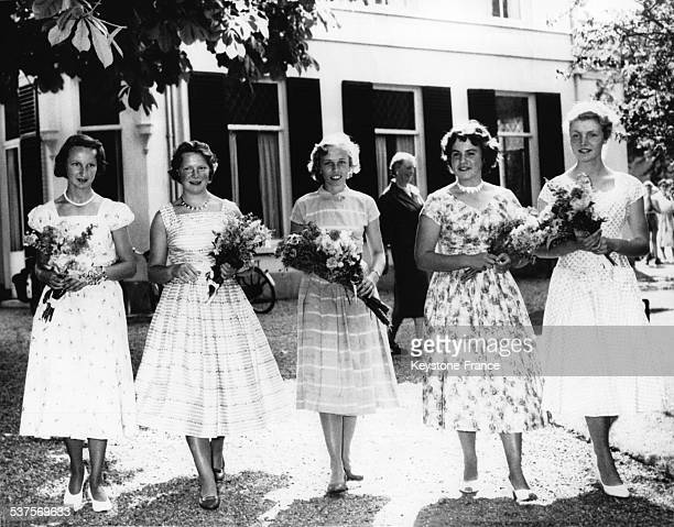 Princess Irene with her friends students during the graduation ceremony each holding in the hand the traditional bouquet of flowers on June 19 1957...
