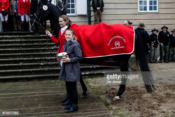 Princess Isabella holds the winner trophy during the yearly Hubertus Hunt at The Woodland Park 'Dyrehaven' on November 5 2017 in Klampenborg Denmark...