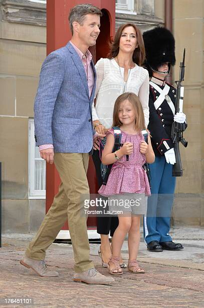 Princess Isabella of Denmark departs Amalienborg Palace escorted by her parents Prince Frederik of Denmark and Princess Mary of Denmark for her first...