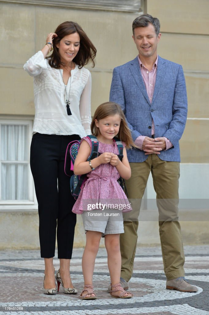 Princess Isabella of Denmark departs Amalienborg Palace escorted by her parents Prince Frederik of Denmark and Princess Mary of Denmark for her first day at Tranegard school on August 13, 2013 in Copenhagen, Denmark.