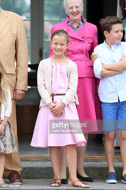 Princess Isabella of Denmark Queen Margrethe II of Denmark and Prince Christian of Denmark pose for photographers at the annual summer photo call for...
