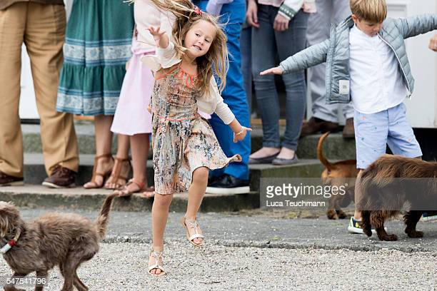 Princess Josephine of Denmark plays with dogs during the annual summer photo call for The Danish Royal Family at Grasten Castle on July 25, 2015 in...