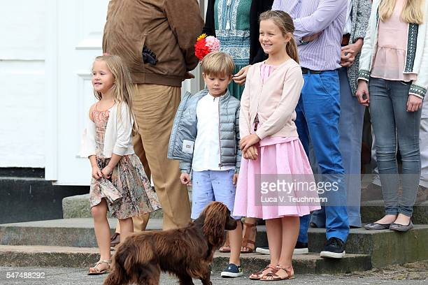 Princess Josephine of Denmark Prince Vincent of Denmark and Princess Isabella of Denmark pose for photographers at the annual summer photo call for...