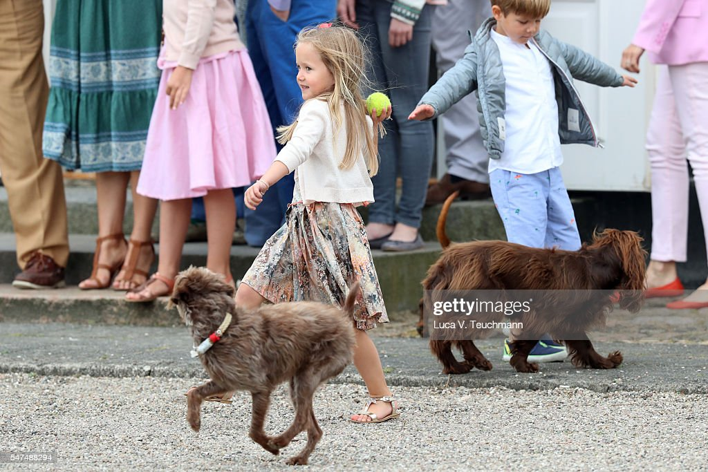Princess Josephine of Denmark throws a ball for a dog during the annual summer photo call for The Danish Royal Family at Grasten Castle on July 15, 2016 in Grasten, Denmark.