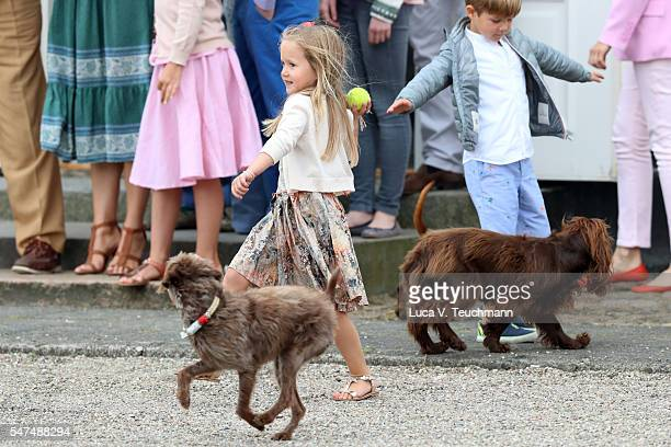Princess Josephine of Denmark throws a ball for a dog during the annual summer photo call for The Danish Royal Family at Grasten Castle on July 15...