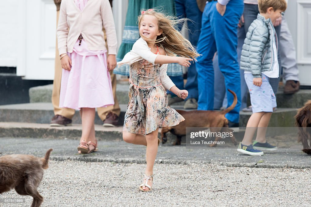 Princess Josephine of Denmark throws a ball for a dog during the annual summer photo call for The Danish Royal Family at Grasten Castle on July 25, 2015 in Grasten, Denmark