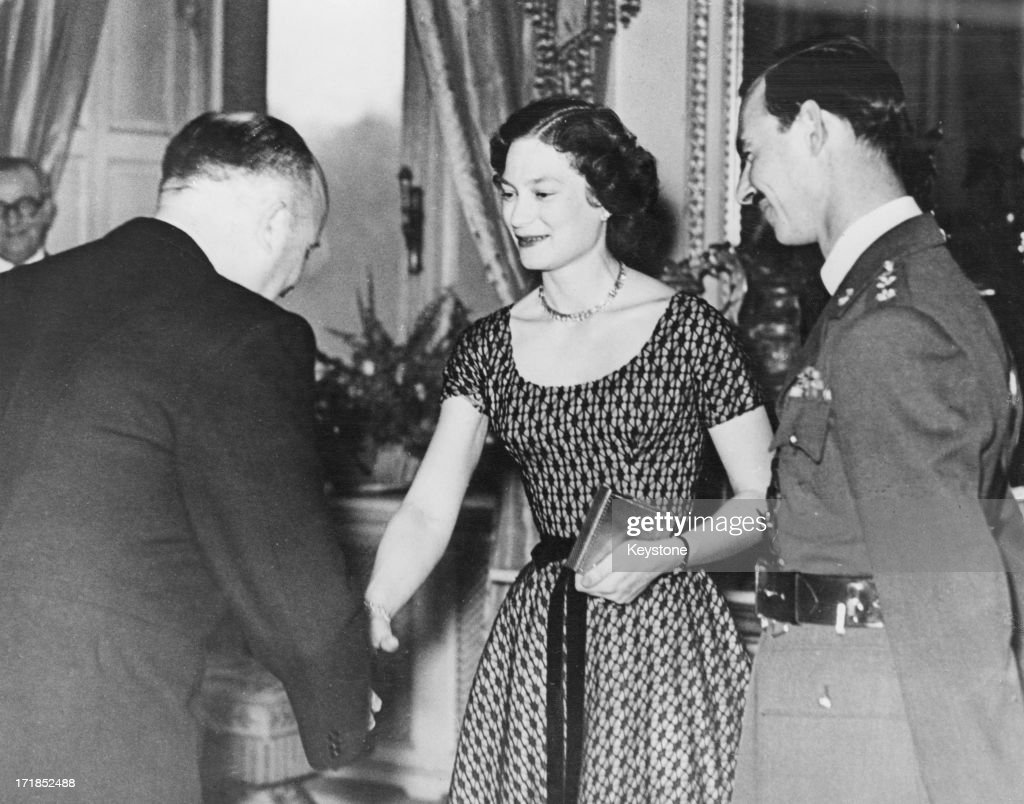 Princess Josephine-Charlotte of Belgium (1927 - 2005) and Grand Duke Jean of Luxembourg are congratulated on their engagement by Jean Van Houtte (1907 - 1991) on behalf of the Belgian Government, Royal Palace of Brussels, 25th March 1953.