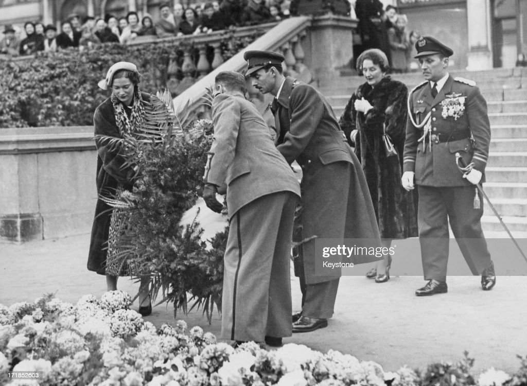 Princess Josephine-Charlotte of Belgium (1927 - 2005) (left) and Grand Duke Jean of Luxembourg (third from right), seen for the first time since their engagement, place a wreath at the Tomb of the Unknown Warrior at the Cathedral of St. Michael and St. Gudula, Brussels, 17th November 1952.