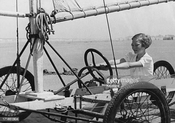 Princess Josephine-Charlotte of Belgium on holiday at De Panne tries out a sand yacht on the beach, Belgium, 25th June 1938.