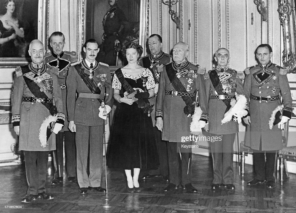 Princess Josephine-Charlotte of Belgium (1927 - 2005) receives the Grand Cross of Honour at the Royal Palace of Brussels. Her fiance, Grand Duke Jean of Luxembourg, is seen on her left, 21st January 1953.