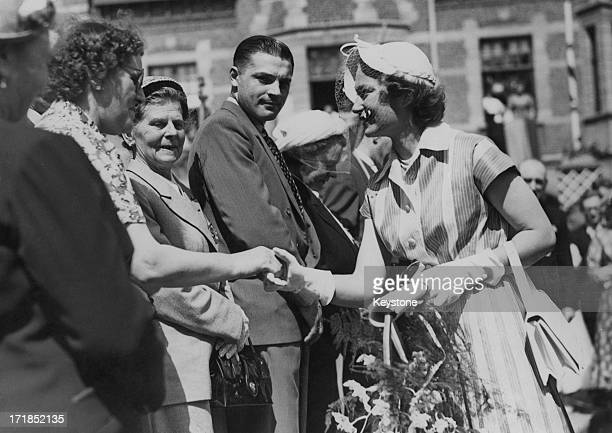 Princess JosephineCharlotte of Belgium shakes hands with a war widow whilst on an official visit to Lokeren Belgium circa 1950