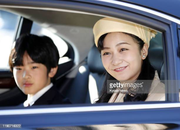 Princess Kako, Emperor Naruhito's niece, smiles on her way to meet former Emperor Akihito and former Empress Michiko at the Imperial Palace in Tokyo...