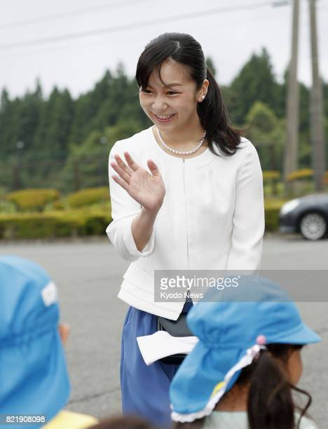 Princess Kako granddaughter of Emperor Akihito and Empress Michiko waves to children upon arrival at the venue of an equestrian event in Gotemba...