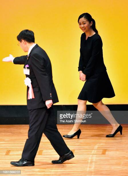 Princess Kako of Akishino is escorted during the opening ceremony of the national high school finger language contest on October 07, 2018 in Yonago,...