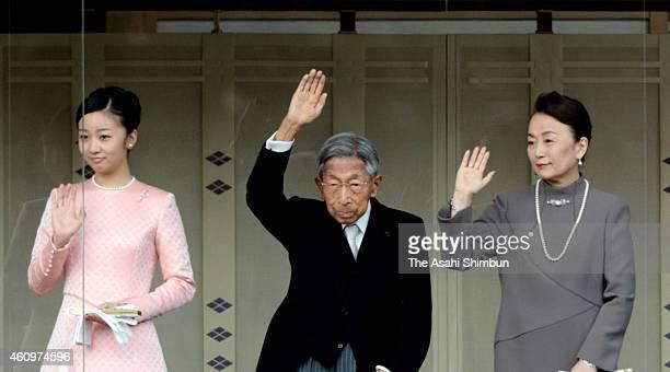 Princess Kako of Akishino, Prince Mikasa and Princess Nobuko of Mikasa wave to well-wishers during the New Year celebration at the Imperial Palace on...