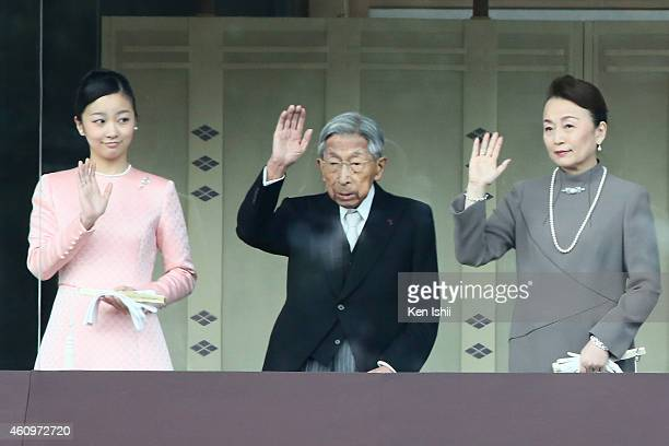 Princess Kako of Akishino, Prince Mikasa and Princess Tomohito of Mikasa wave to well-wishers during the celebration for the New Year on the veranda...
