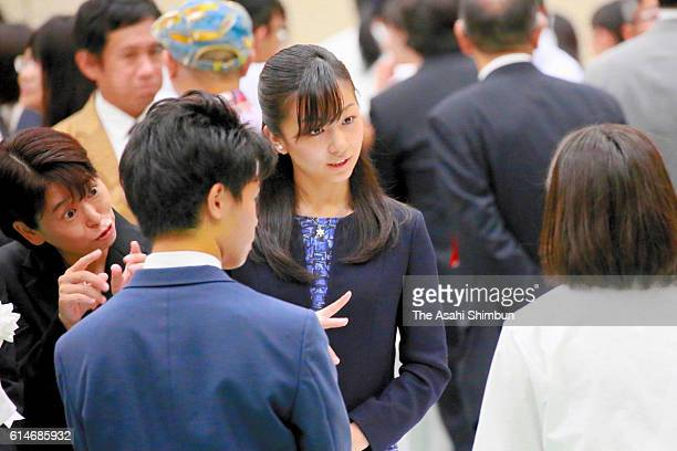 Princess Kako of Akishino talks to a high school student during a reception of the National High School Sign Language Performance Championship on...
