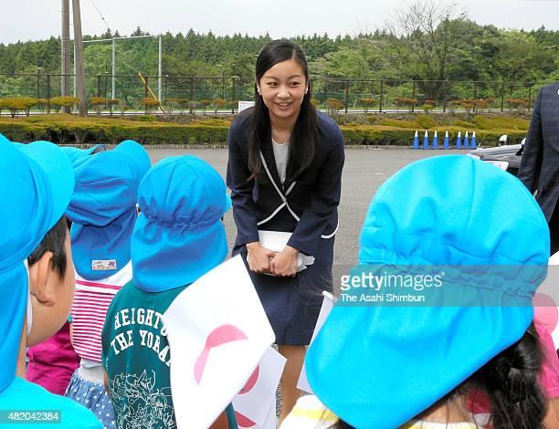 Princess Kako of Akishino talks to kindergarten children on arrival prior to the All Japan High School Equastrian Championships Opening Ceremony on...