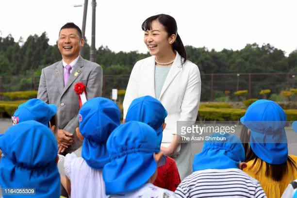 Princess Kako of Akishino talks with kindergarten children on arrival at the Japan High School Equestrian Championships on July 24, 2019 in Gotemba,...
