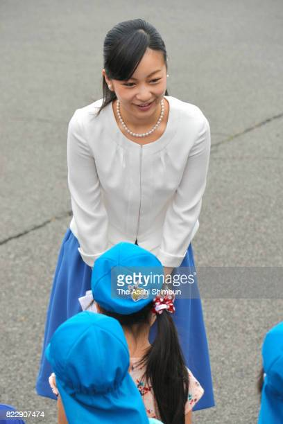 Princess Kako of Akishino talks with kindergarten children on arrival at the 51st All Japan High School Equestrian Championships at the Gotemba City...