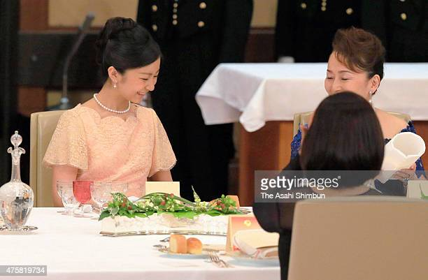 Princess Kako of Akishino talks with Princess Nobuko of Mikasa during the state dinner inviting Philippine President Benigno Aquino at the Imperial...