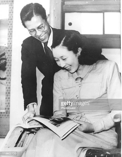 Princess Kazuko aka Princess Taka daughter of Japanese Emperor Hirohito shares a laugh with her fiance Toshimichi Takatsukasa as they look at a...