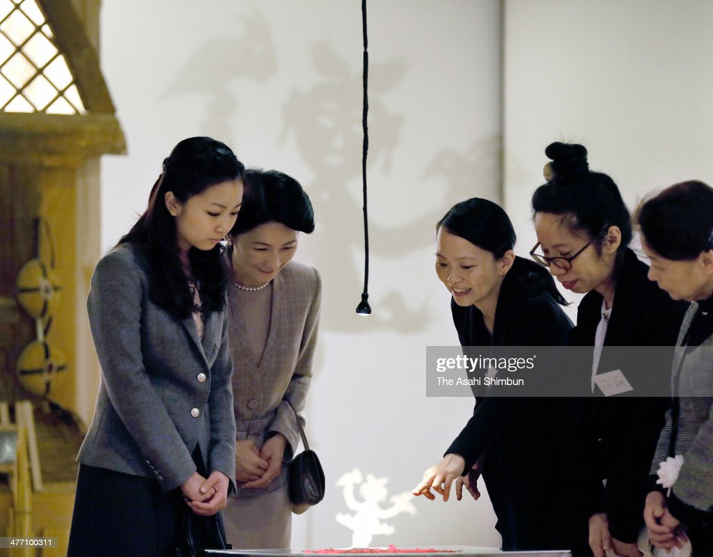 Princess Kiko (2nd L) and her daughter Princess Kako of Akishino (1st L) visit a Chinese traditional paper cutout exhibition at Carrot Tower on March 7, 2014 in Tokyo, Japan.