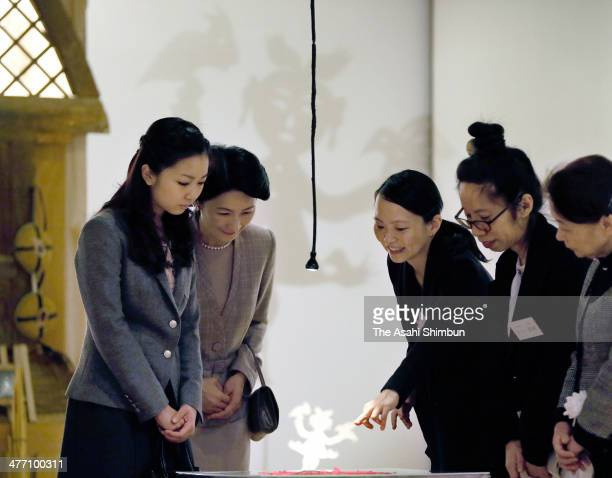 Princess Kiko and her daughter Princess Kako of Akishino visit a Chinese traditional paper cutout exhibition at Carrot Tower on March 7, 2014 in...