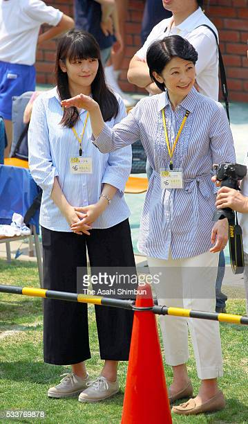 Princess Kiko and her elder daughter Princess Mako watch Prince Hisahito during the Ochanomizu Elementary School sports festival on May 21 2016 in...