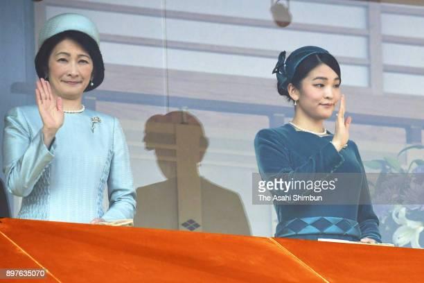 Princess Kiko and Princess Mako of Akishino wave to wellwishers during a session celebrating Emperor Akihito's 84th birthday at the Imperial Palace...
