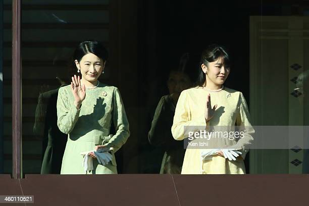 Princess Kiko and Princess Mako of Akishino wave to wellwishers during celebrations for the New Year on the veranda of the Imperial Palace on January...