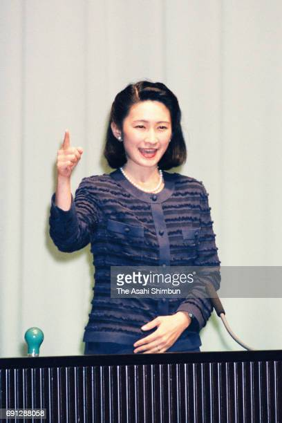 Princess Kiko of Akishino addresses with finger language during a finger language speech contest at Yurakucho Asahi Hall on August 24 1997 in Tokyo...