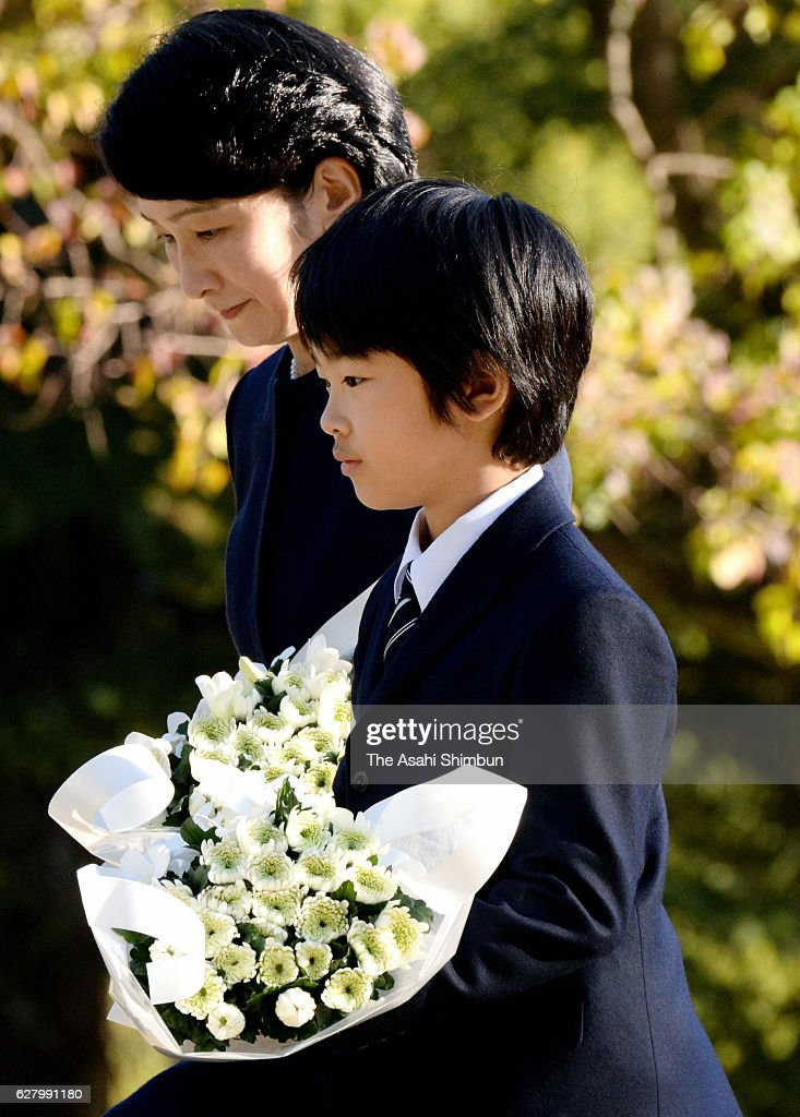 Princess Kiko of Akishino and her son Prince Hisahito offer flowers at the A-bomb Hypocenter Memorial at Nagasaki Hypocenter Park on December 6, 2016 in Nagasaki, Japan.