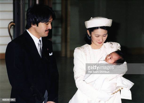 Princess Kiko of Akishino holds her second daughter Kako while Prince Akishino watch after visiting Emperor Akihito and Empress Michiko for the first...