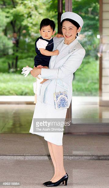 Princess Kiko of Akishino holds Prince Hisahito upon arrival at the Imperial Palace to greet the Emperor and the Empress on September 6 2007 in Tokyo...