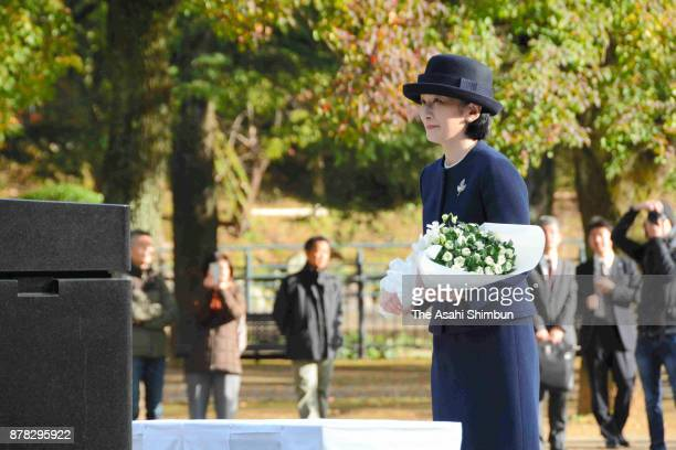 Princess Kiko of Akishino offer a flower bunch at the Hypocenter Cenotaph of the Nagasaki Atomic Bomb as she visits there with Princess Laurentien of...