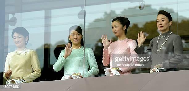 Princess Kiko of Akishino, Princess Mako of Akishino, Princess Kako of Akishino and Princess Nobuko of Mikasa wave to well-wishers during the New...