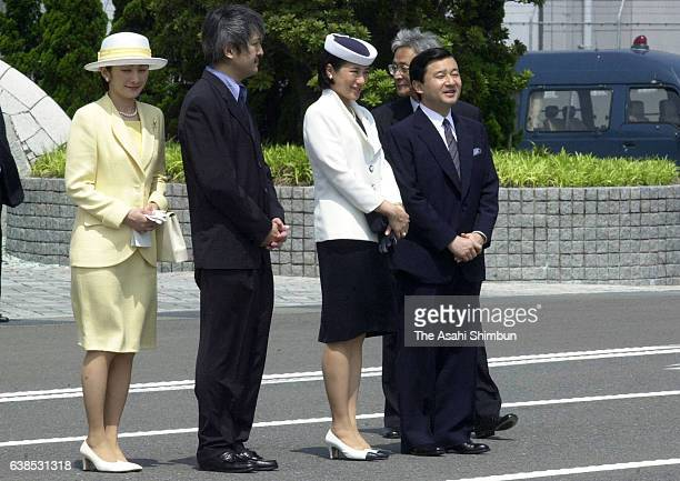 Princess Kiko Prince Akishino Crown Princess Masako and Crown Prince Naruhito wait for the arrival of Emperor and Empress at Haneda International...
