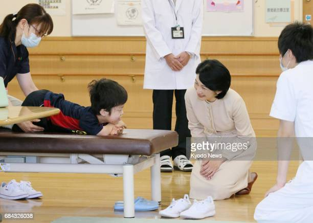 Princess Kiko visits a medical facility for children in the northeastern Japan city of Sapporo on May 18 in her first public appearance since it was...
