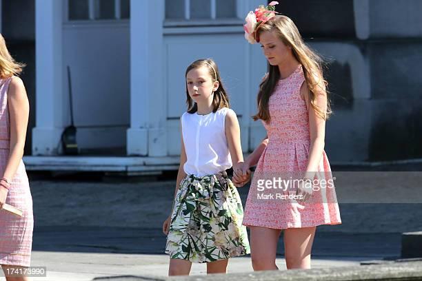 Princess Laetitia Maria of Belgium and Princess Luisa Maria of Belgium attend the Civil and Military Parade during the Abdication Of King Albert II...